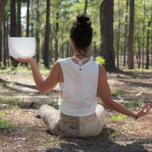 Jeny Dawson Holding Crystal Bowl In Woods