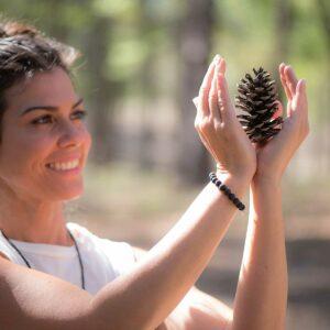 Jeny Dawson Holding A Pine Cone